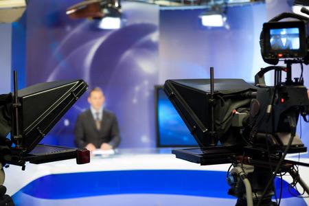 Foto de Video camera lens - recording show in TV studio - focus on camera - Imagen libre de derechos