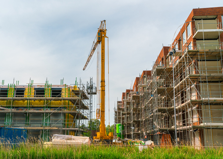 Foto de Amsterdam, The Netherlands, May 22 2017: The building of new houses and appartments in the west part of Amsterdam - Imagen libre de derechos