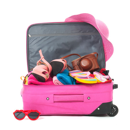 Foto de Packing the pink suitcase for the summer vacation - Imagen libre de derechos