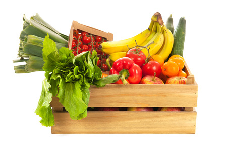 Wooden crate fresh vegetables and fruit isolated over white