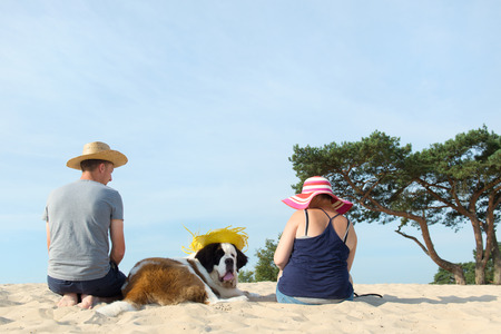 Owners with their big dog at the beach