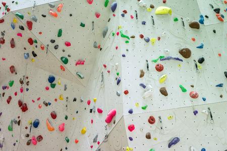 Foto de Indoor Climbing gym wall detail close up - Imagen libre de derechos
