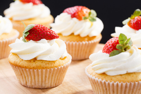 Photo for strawberry capcake in a cardboard box on an olive board - Royalty Free Image