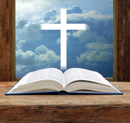 Foto de Bible christian cross stormy sky view window open wood - Imagen libre de derechos