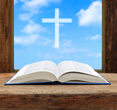 Photo pour Bible open christian cross light sky view window wooden shallow DOF - image libre de droit
