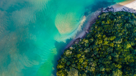 Photo pour Aerial view of a beautiful ocean and white sandy beach at Bukit Keluang, Terengganu, Malaysia from a drone - image libre de droit