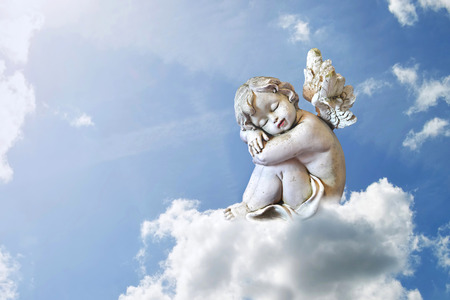 Photo for Little angel sleeping on the cloud - Royalty Free Image