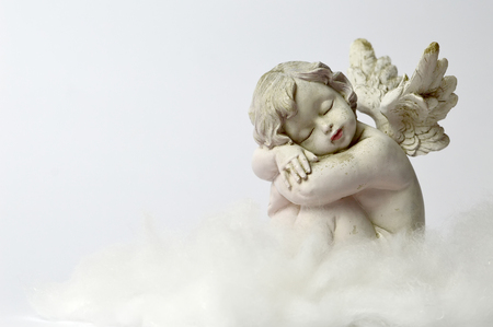 Photo for Angel sleeping on the cloud - Royalty Free Image