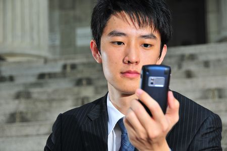 Business Man with PDA phone 5