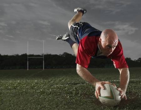 Rugby Player making a Score