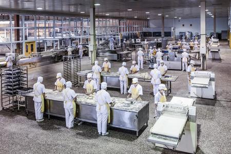 Photo pour Workers in the food production factory - image libre de droit