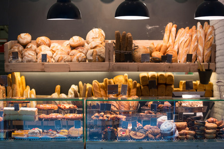 Photo for Modern bakery with different kinds of bread, cakes and buns - Royalty Free Image