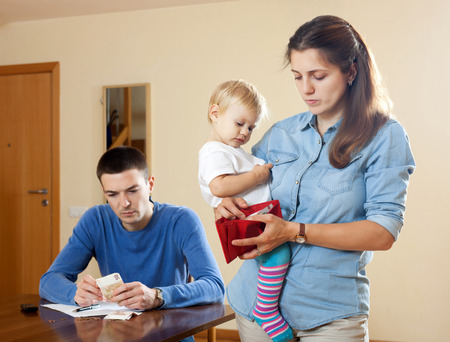 Photo pour Financial problems have man and wife  with baby - image libre de droit