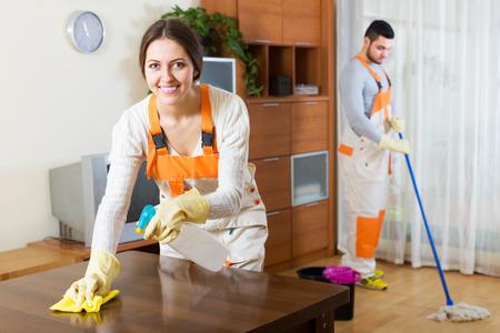 Photo pour Happy professional cleaners with equipment clean of client house - image libre de droit