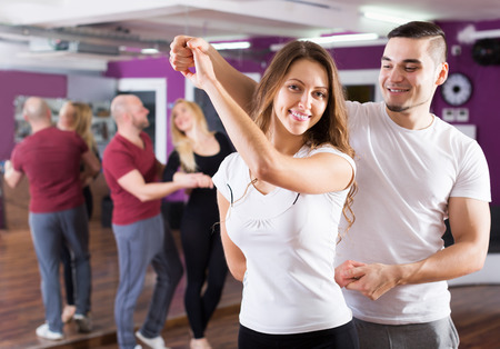 Photo for Happy adult couples enjoying of partner dance indoor - Royalty Free Image