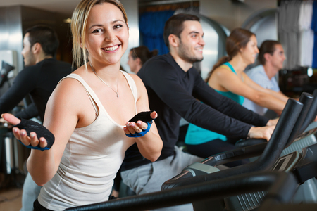 Foto per Group working out of cycling in modern fitness club - Immagine Royalty Free