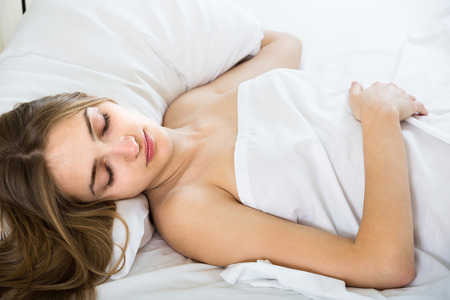 Photo for Portrait of charming longhaired blonde young woman sleeping in bed - Royalty Free Image