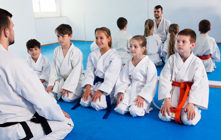 Photo for Different ages kids expressing interest in attending karate class - Royalty Free Image