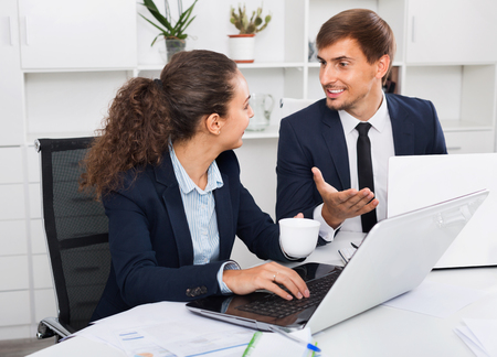 Photo for Two diligent glad smiling business male and female assistants wearing formalwear having work conversation in company office - Royalty Free Image