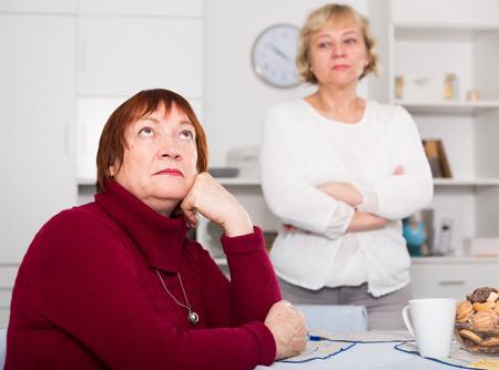 Photo pour Portrait of mature females quarreling and disagreement indoors - image libre de droit
