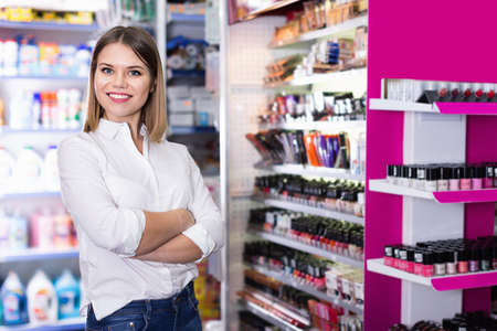 Photo for Portrait of attractive confident cheerful positive smiling salesgirl in cosmetics shop - Royalty Free Image