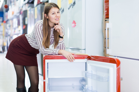 Photo for Portrait of young attractive saleswoman in store of house appliances - Royalty Free Image