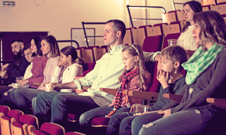 Photo for Audience attending movie night for comedy in cinema - Royalty Free Image