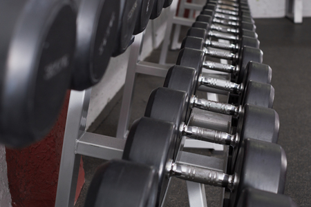 Photo for Dumbbell weights on rack for training equipment in gym - Royalty Free Image