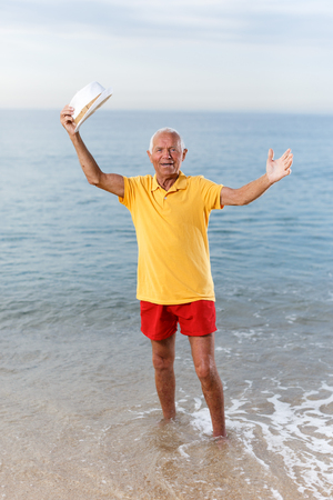 Photo for Active satisfied mature man posing near ocean alone - Royalty Free Image