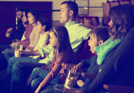 Photo for Young people watching exciting movie in cinema house - Royalty Free Image