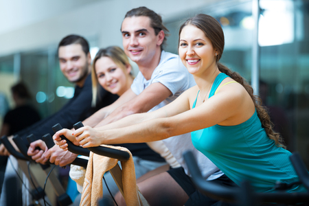 Foto per Group of people training on exercise bikes in gym - Immagine Royalty Free