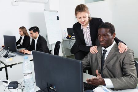 Foto de Sexual harassment between two satisfied pleasant colleagues and flirting in office - Imagen libre de derechos