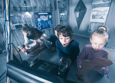 Photo for Group of children are concentrating on finding a way out of mysterious bunker - Royalty Free Image