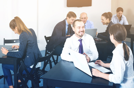 Photo pour smiling spanish people working productively on business project together in office - image libre de droit