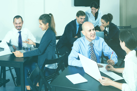 Photo pour smiling people working productively on business project together in office - image libre de droit