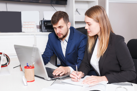 Photo for Portrait of successful young salespeople working on laptop in furniture salon - Royalty Free Image