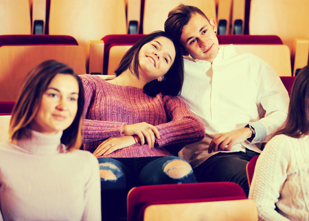 Photo for Loving young couple enjoying a pastime in the theater - Royalty Free Image