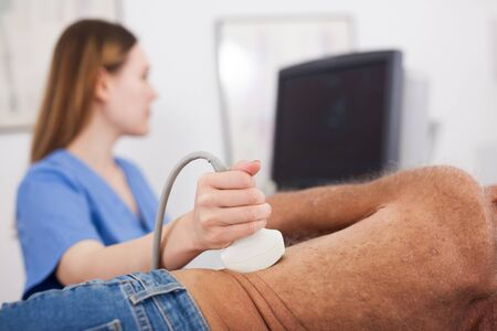 Photo for Close up of sonographer using ultrasound probe for ultrasonic patient examination - Royalty Free Image