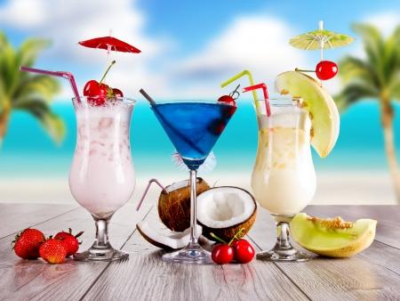 Summer drinks with blur beach on background