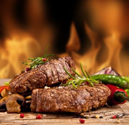 Delicious beef steakes on wood