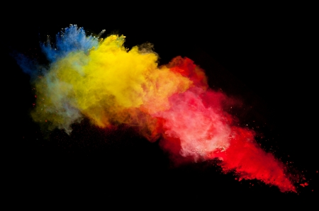 Photo for Freeze motion of colored dust explosion isolated on black background - Royalty Free Image