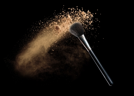 Photo pour Isolated make-up powder with brush on black background - image libre de droit