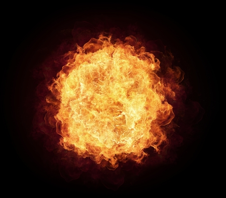 Foto de Fire ball with free space for text. isolated on black background - Imagen libre de derechos