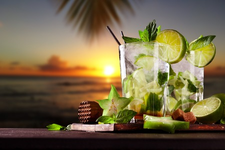 Photo for Mojito drinks on wood with evening blur ocean shore background - Royalty Free Image
