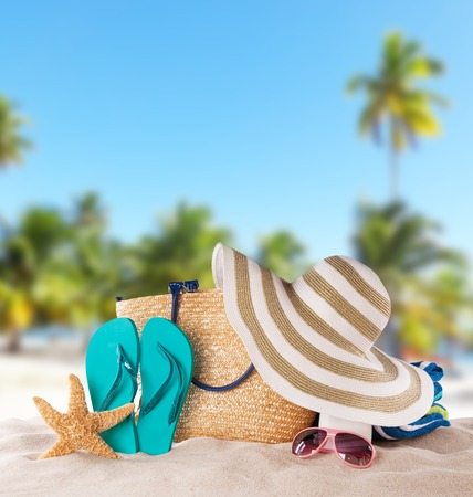 Foto de Summer concept with accessories on sandy beach - Imagen libre de derechos