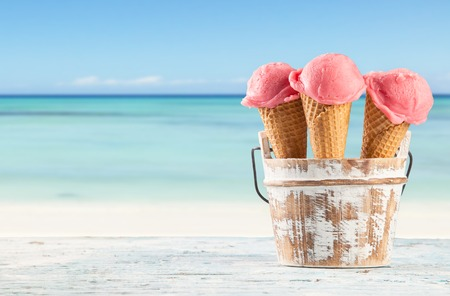 Photo for Fruit ice cream with blur beach as background  Served on wooden planks - Royalty Free Image