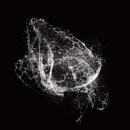 Foto de Water splash isolated on black background - Imagen libre de derechos