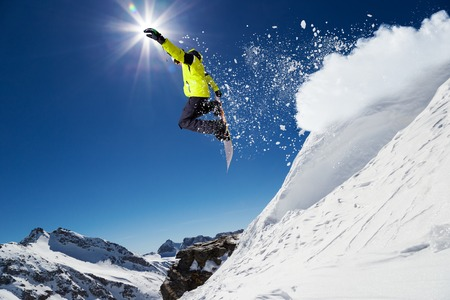 Foto de Alpine skier skiing downhill, blue sky on background - Imagen libre de derechos