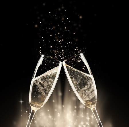 Foto de Two glasses of champagne with splash, on black background - Imagen libre de derechos