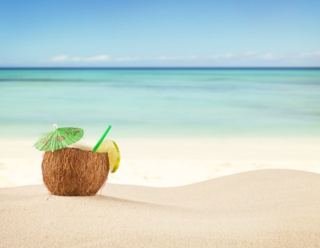 Photo for Sandy beach with fresh drink in pineapple fruit - Royalty Free Image